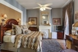 <h5>Balcony Queen</h5><p>Upstairs guest room featuring Stearns & Foster queen sized bed, private bath and custom linens.</p>
